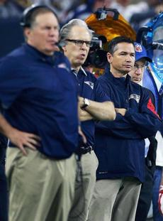 Alex Guerrero (backround right), the close friend of Patriots quarterback Tom Brady (not pictured) was shown on the sidelines at NRG Stadium.